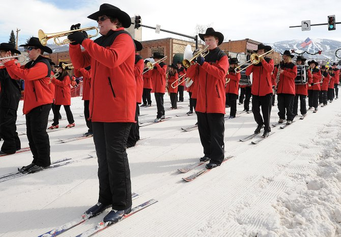 The Steamboat Springs High School Ski Band makes its way down Lincoln Avenue during the annual Diamond Hitch Parade in 2010. The ski band is a longstanding Winter Carnival tradition.