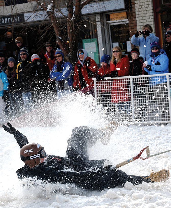 Steamboat Springs resident David Lamb skids through the snow during the popular adult shovel race at Winter Carnival in 2010.