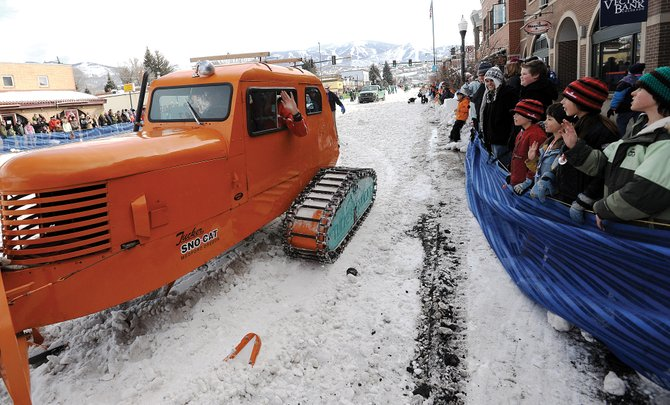 Mike Darrah, of Boulder, waves from the driver's seat of his 1949 Tucker Snowcat during the Diamond Hitch Parade on Lincoln Avenue in downtown Steamboat in 2010. This year's parade starts at 11:30 a.m. Feb. 6.