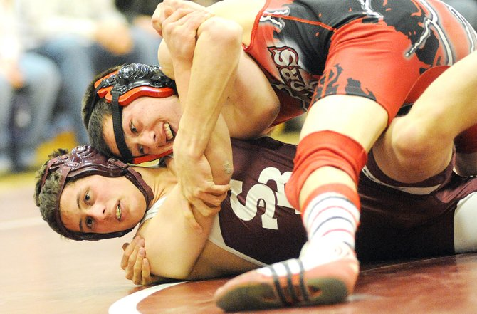 Steamboat's Casey Williams tries to roll Soroco's Tristan Palyo in an exhibition match on Thursday during a wrestling triangular at Soroco High School. Williams went 2-0 on the day, winning twice against Soroco and helping the Sailors to a 2-0 overall record, with wins against the Rams and West Grand.