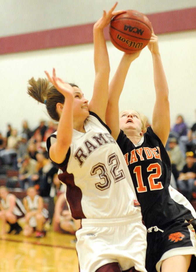 Soroco's Ceanna Rossi blocks a shot from Hayden's Sierra Ehlers on Friday. Soroco took a double-digit lead in the first but couldn't hang on against their cross-county rivals, falling 60-46.