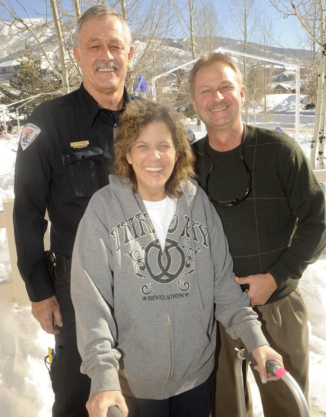 Steamboat Springs resident Michele Dunklin, center, continues her recovery from a car accident at the Doak Walker Care Center. She looks forward to returning home to her husband, Steve, right. Michele Dunklin credits West Routt Fire Protection District Chief Bryan Rickman, left, with helping to save her life.