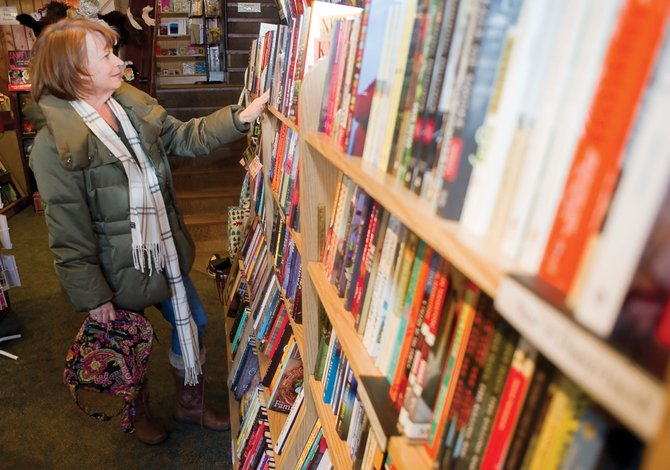 Nancy Heaney browses through the books at the Off the Beaten Path Bookstore in downtown Steamboat Springs. The store is offering customers Google eBooks through its website.