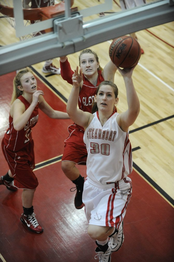 Steamboat Springs High School senior Katie Lettunich puts up a shot during the fourth quarter of Saturday's game against Glenwood Springs High School. Glenwood won, 60-34.