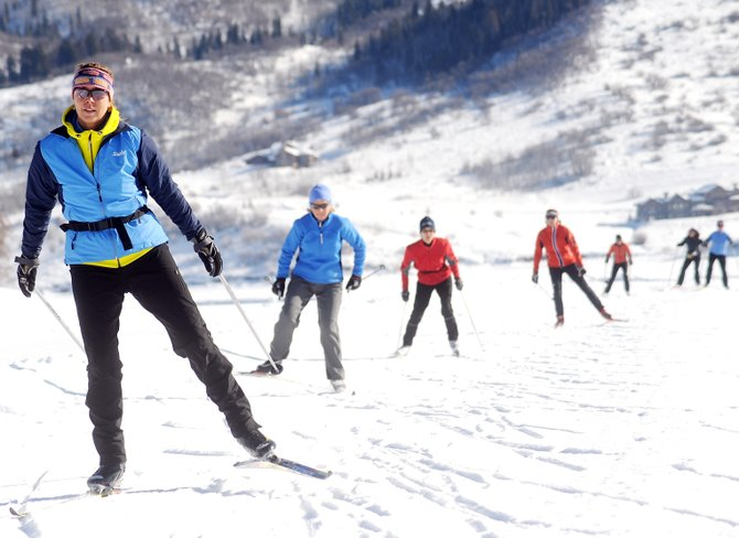 Kathy McKinstry leads a pack of skiers Friday during the Womens Fitness Series skate-ski clinic at Lake Catamount near Steamboat Springs. The series includes one class a week for four weeks and starts up with a new series Friday. It costs $125 and is open to skiers of all levels.