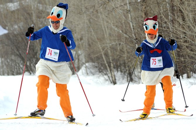 TJ Thrasher and Tasha Thrasher ski like ducks — Donald and Daisy, to be specific — on Sunday during the Colorado Ski For Women event in Steamboat Springs.