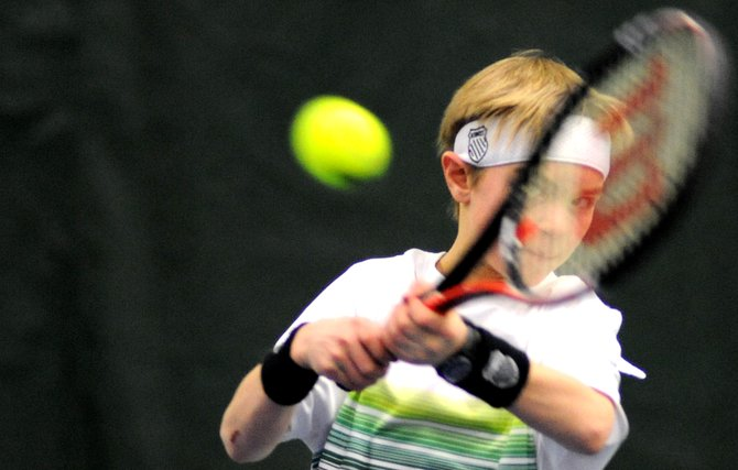 Hayden Snyder, 10, eyes a return on Sunday during the final day of the City Mixed Doubles and Juniors Champions at the Tennis Center in Steamboat Springs. Snyder played in the Intermediate-Advanced boys division, which Charlie Smith won thanks to outlasting Snyder in a tiebreaker.
