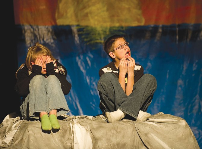 "Peter Pan, played by William Lighthizer, and Wendy, played by Alli Ingols-Irwin, react after finding a way to escape an island surrounded by rising waters in a scene from ""Peter Pan & Wendy."" Class Acts Productions will present the play at 7 p.m. Friday and 3 p.m. Saturday in the Hayden Secondary Schools auditorium."