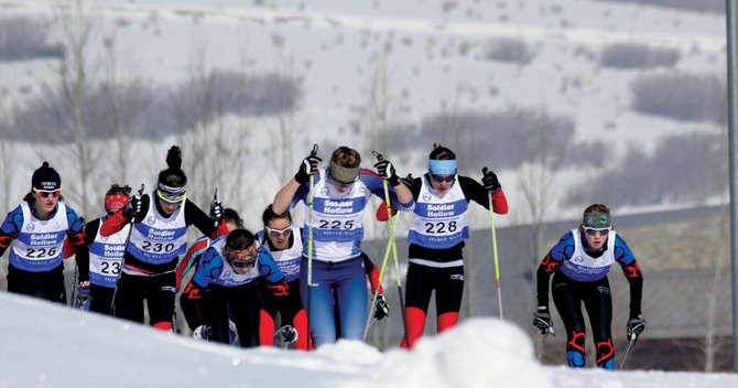 Steamboat Springs Winter Sports Club skiers including Haley Piske, Lucy Newman, Mary O'Connell and Emily Hannah chase leader and eventual winner Annie Pokorny, No. 225, at a cross-country race during the weekend at Soldier Hollow, Utah.