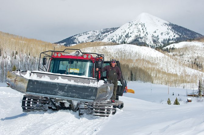 The Steamboat Lake Snow Club is trying to raise funds for a new groomer during its Snow Carnival, which will be held Feb. 19. Billy Dines, who has been driving the snowcats in North Routt for nearly two decades, stands on the snowcat that is being used to groom trails in the area.