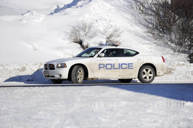 Steamboat Springs Police Department officer Sam Silva works Tuesday inside the department's newest patrol vehicle, an all-wheel-drive Dodge Charger. The smaller car was cheaper than the other option available to the city, a Chevrolet Tahoe.