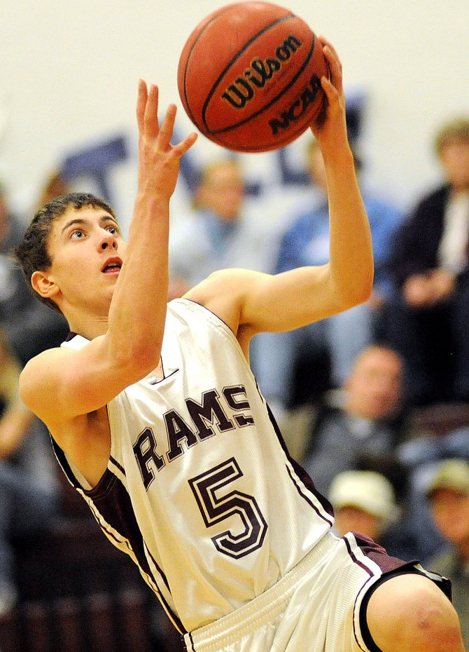 Soroco's Michael Rossi goes up for a layup late in Friday night's win against North Park.  The Wildcats put together a wild fourth-quarter rally, but the Rams were too good earlier in the game and managed to hang on to win, 46-43.