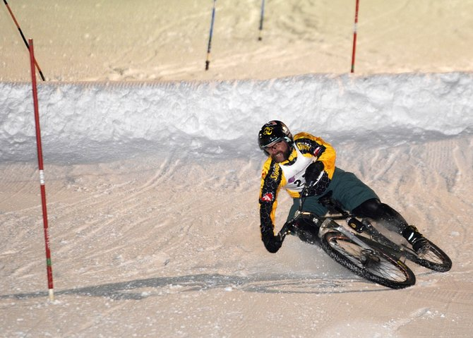Rob Peterson falls during Friday's Winter Carnival bike slalom at Howelsen Hill. The event has been a part of Winter Carnival for 20 years.