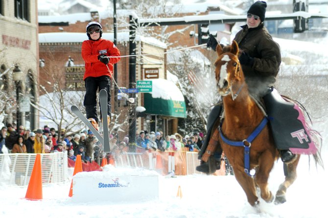 Noel Keeffe flies off the donkey jump during the Winter Carnival in Steamboat Springs. Keeffe flew 37.5 feet to win Sunday&#39;s competition.