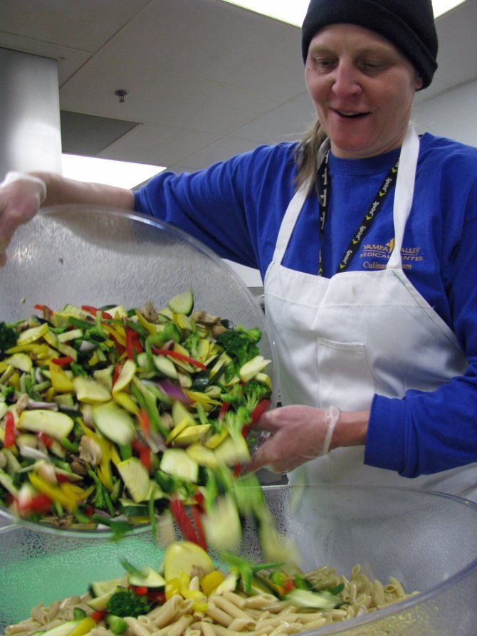 Yampa Valley Medical Center chef Meredith Herndon prepares pasta primavera, a meatless dish that often is featured on the hospital cafeteria menu.
