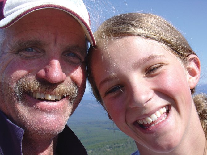 Chris McNeill with his daughter Dori on top of Comet Mountain in Polaris, Mont., in 2009.
