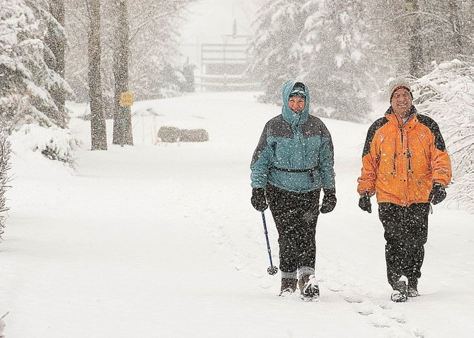 The city's pending purchase of 586 acres on Emerald Mountain is adding a $755,000 expense to a budget strapped by declining funds for capital projects. The purchase could reduce funds available for future projects, such as an extension of Yampa River Core Trail, which Judy and David Saunders, of Chicago, enjoyed during a snowy day in April 2010.