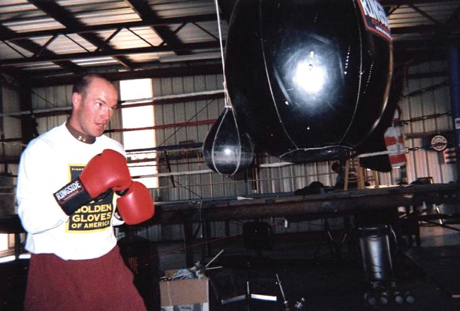 Tyler Pogline, a 1998 Moffat County High School graduate, is seen here training in his Colorado Springs boxing gym, Busted Knuckle. Pogline recently lost his first professional televised fight, a close judges' decision Jan. 22 in Las Vegas.