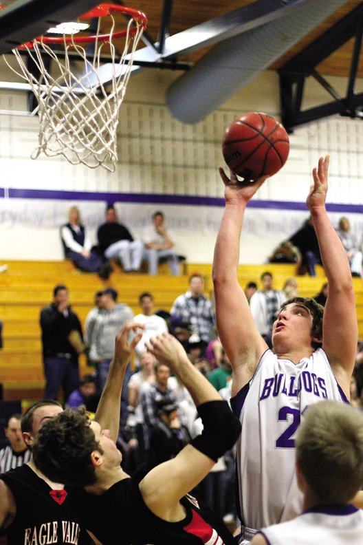 Angelo Raftopoulos, a Moffat County High School senior, puts up a shot Friday in the Bulldogs game against Eagle Valley. The Bulldogs jumped out to an early lead Saturday against Battle Mountain, but the Huskies used a big third quarter to win, 66-58.