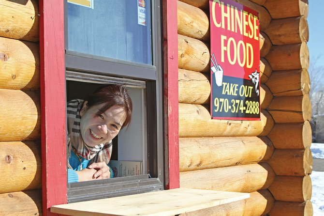 Phan Voong, 42, leans out of the window of the Terrace Chinese Take Out on Thursday.