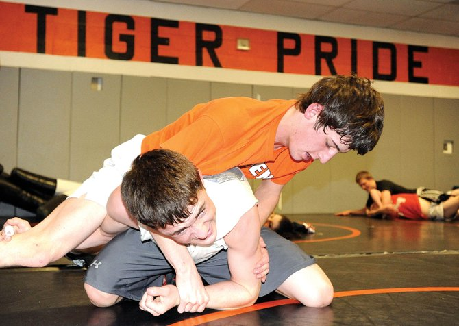 Hayden senior Scott Armbruster, top, wrestles teammate Tyler Paxton on Thursday. Armbruster will attempt to qualify for the state wrestling tournament for a fourth time starting today at the regional tournament in Palisade.
