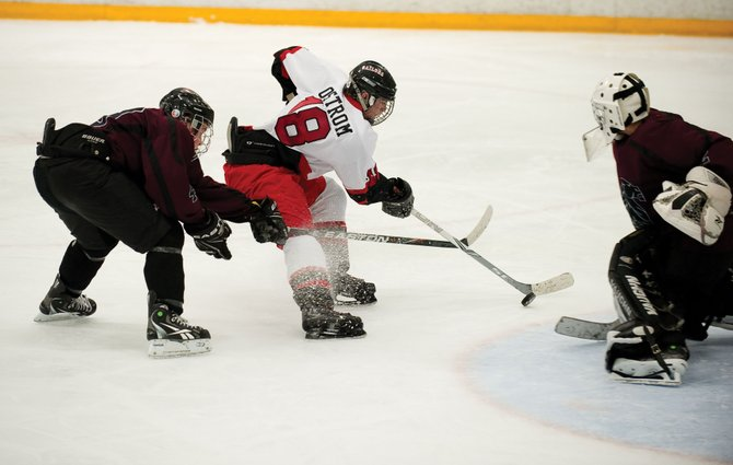 Steamboat Springs Junior Lance Ostrom takes a shot against Chatfield goalkeeper Matt Smith in the third period of Friday night's game at the Howelsen Ice Arena. Ostrom scored in the third period to pull the Sailors within a goal of the top-ranked Chargers, but two late goals helped Chatfield escape Steamboat Springs with the win.