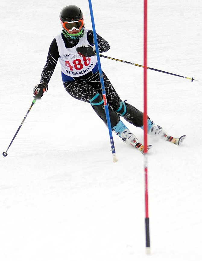 Steamboat's Suzanne Lyon races toward the finish of her second run Friday at a high school slalom race at Howelsen Hill in Steamboat Springs. Lyon finished 11th, bouncing back from a bad first run with a great second try. Her teammate, Sarah White, was great on both her turns, winning the event and paving the way as Steamboat won both the boys and girls team titles.