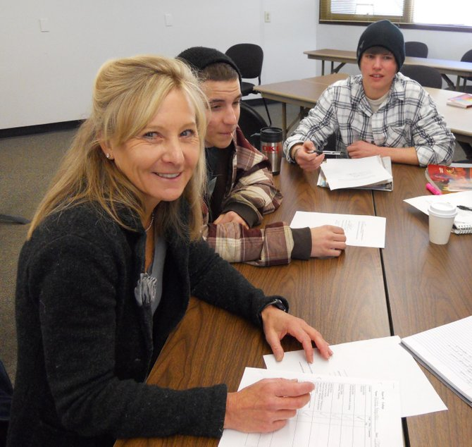 Jen le Roux, left, works with students Shane Berube, center, and Nicholas Beran last week during the developmental English class she teaches at Colorado Mountain College's Alpine Campus. Le Roux, who also teaches English as a second language, was named CMC's faculty member of the year.