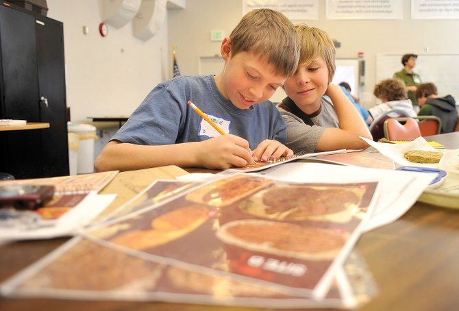 South Routt Elementary School students Lance Bryant, left, and Colton Stroup complete a project focusing on paleo-climatology during the Science Explorers program put on by University of Colorado and sponsored by Northwest Colorado Board of Cooperative Educational Services.