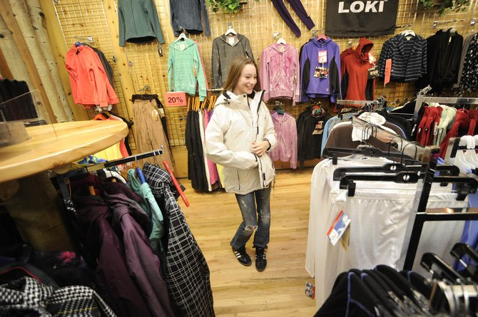 Sage Sullivan, 14, tries on a coat Saturday at Allen's clothing store in downtown Steamboat Springs. The 2010 sales tax revenues came in at about $16.7 million, compared with the nearly $15 million initially forecast.