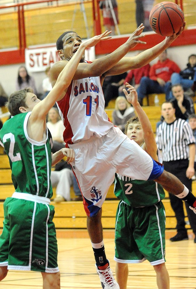 Steamboat's Randall Nelson drives for a layup Saturday as the Sailors beat Delta, 74-46.