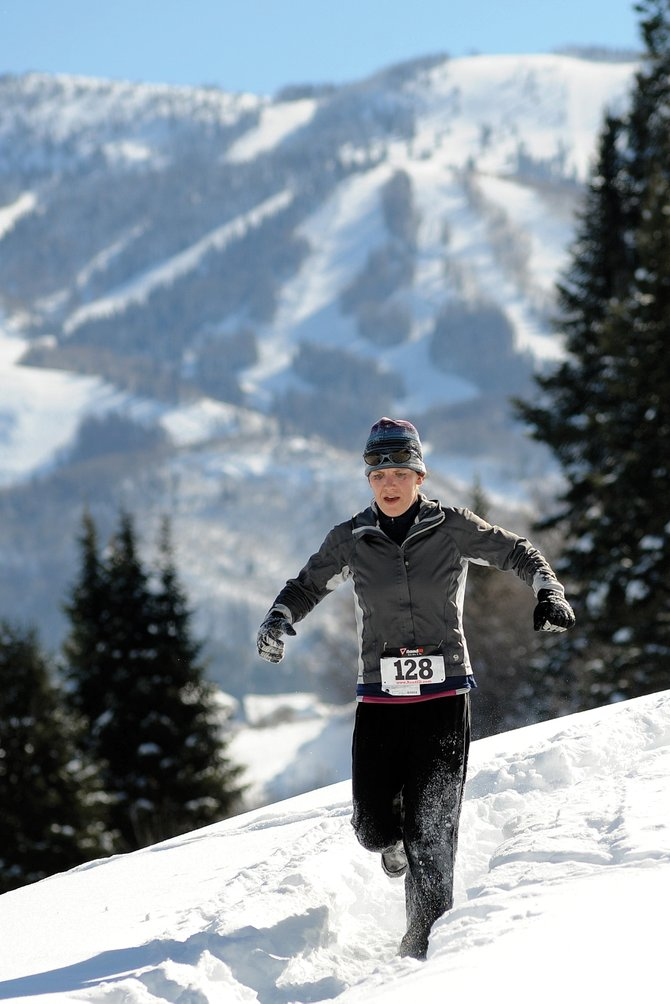 Deirdre Pepin makes her way down the course during Sunday's Love the Run You're With 10-kilometer running race at Howelsen Hill in Steamboat Springs. Deep snow conditions made running on the trails difficult. It didn't keep Pepin from winning the women's division, however.