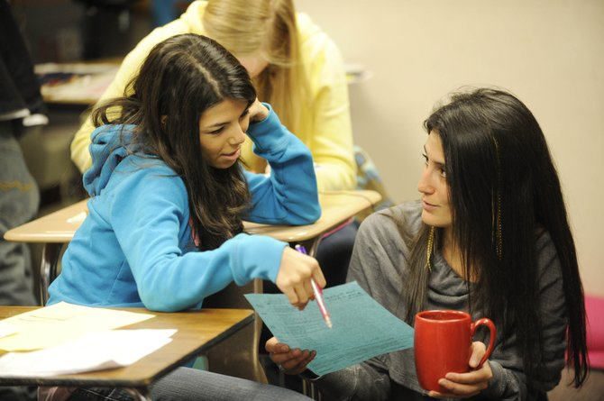 Steamboat Springs High School English teacher Jennifer Gabriel, right, helps 11th-grader Jennifer Bean select courses Thursday.