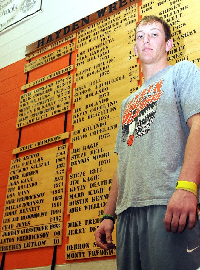 All of Hayden's wrestling state champions are immortalized on a wall in the school's gymnasium. Tigers' senior Treyben Letlow made the wall with his victory last year at state in the 215-pound class. He hopes to climb it starting today as he wrestles for a second state title. If he wins, he'd cap off his second-consecutive perfect season, have won 71 matches in a row and be considered one of the best wrestlers in the school's history.
