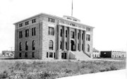 Pictured here is the Moffat County Courthouse in 1918. Moffat County was formed in February 1911 and for the first six years, the county operated out of a building at the corner of Breeze Street and Main Street, which is now Victory Way. The new courthouse was completed in 1917 and Craig photographer George Welch took this photo of the newly completed structure.