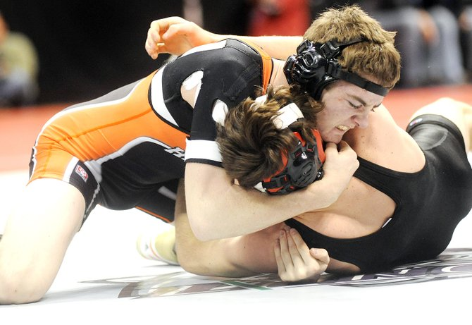 Hayden junior Chad Terry pushes for a pin on Friday while wrestling Justin Westphal of Baca County. Terry got the pin and advanced to wrestle in the state semifinals for the third time in as many years.