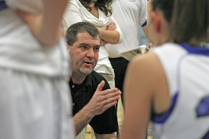 Matt Ray, Moffat County High School girls basketball coach, huddles with his players Friday during a rivalry game against Steamboat Springs. Ray took over for longtime head coach Craig Mortensen after he retired at the end of last season, and won a share of the WSL crown in his first year.