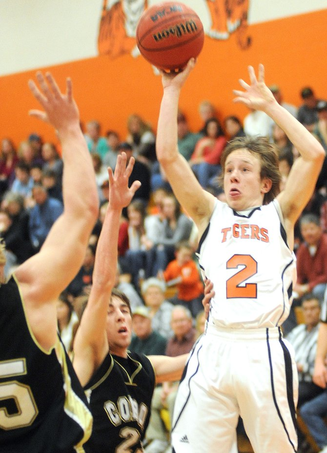 Hayden's Hunter Johnston rises up for a shot in the first half of Friday night's district semifinal game in Hayden. The Tigers exploded in the second half to beat Meeker. They'll face Paonia today in the district championship.