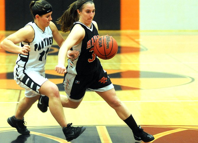 Hayden's Delanie VeDepo beats her defender around the corner Friday as the Tigers knocked off Rangely in Hayden to advance to the district championship game.
