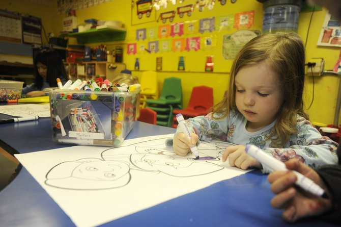 Laurel Street Preschool student Baylee Walker, 4, colors Friday afternoon. Local education leaders are worried that Colorado Gov. John Hickenlooper's proposed budget cuts will have a direct impact on early childhood programs.