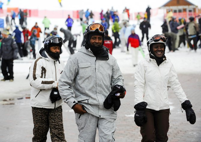 National Brotherhood of Skiers Black Ski Summit 2011 attendees, from right, Kathy Lloyd, Travis Garrett and Butch Mikell walk through Gondola Square on Saturday.