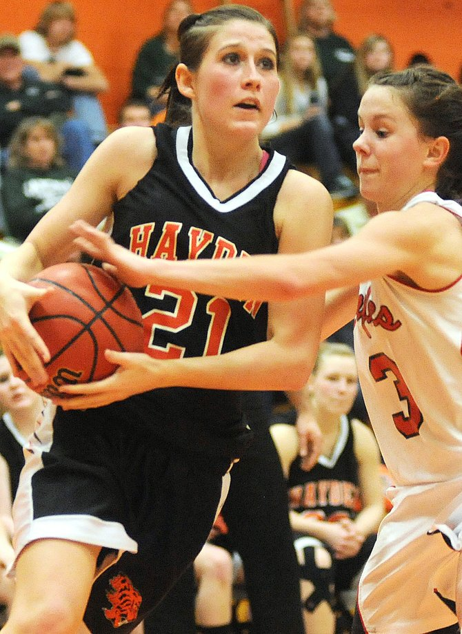 Hayden's Kyra Rolando draws a foul while driving to the basket in Saturday's district championship game. The Tigers lost, 34-33.
