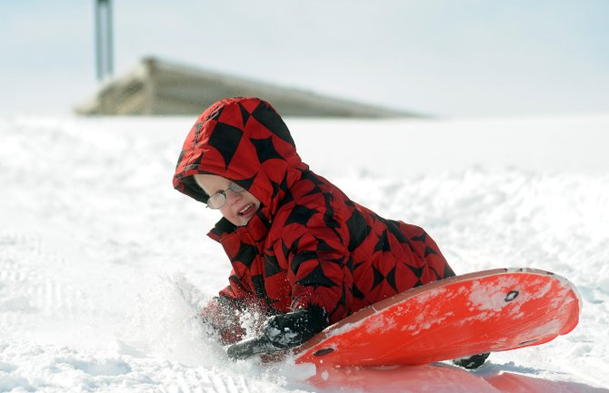 Chase Preston, 5, flies down a sledding hill on Sunday at Stagecoach Reservoir. The reservoir played host to a Cure Your Cabin Fever day, which included hot chocolate, sledding and ice fishing lessons.