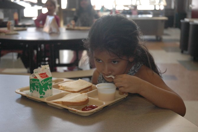 Soda Creek Elementary School kindergartner Lauren Rodriguez eats lunch Monday. She and the rest of the district's students will get low-sodium meals this month, an effort by Nutritional Services Director Max Huppert to meet new federal nutrition standards that were proposed in January.