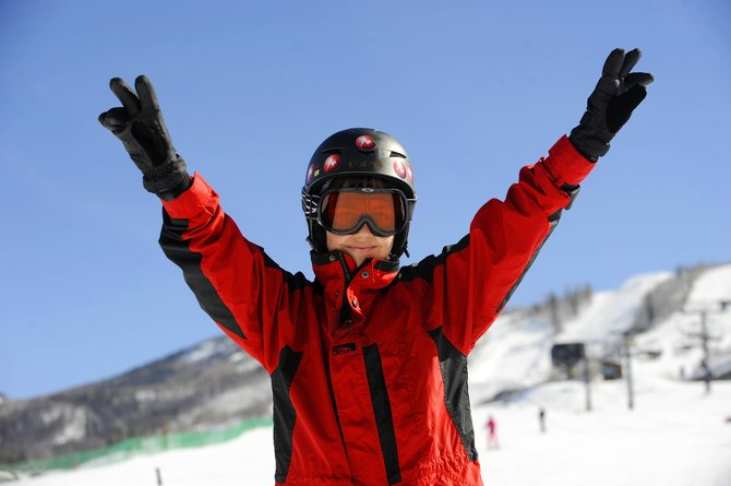 Leslie Figueroa, 14, of New Jersey, celebrates completing a run Tuesday morning at Steamboat Ski Area. Leslie is one of about 25 teenage cancer patients participating in the 29th annual Sunshine Kids Winter Games in Steamboat Springs.