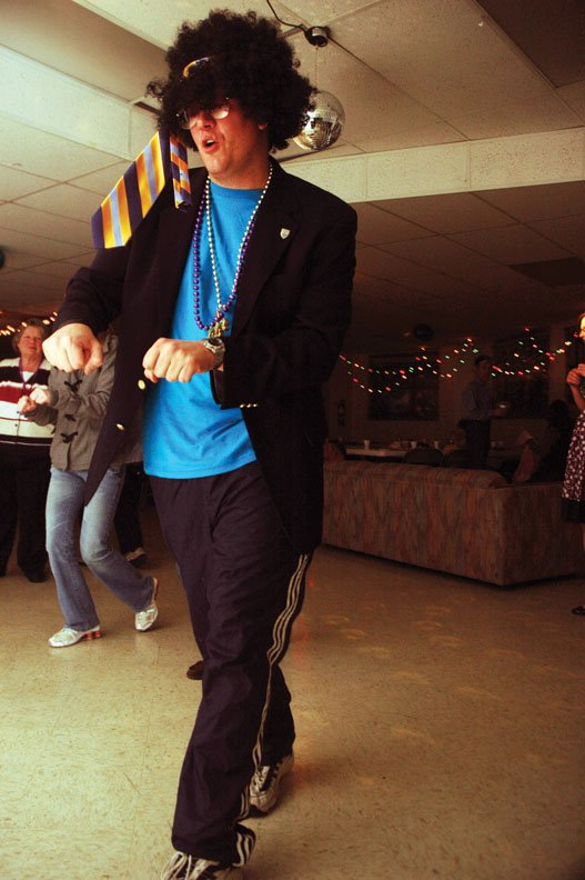 Father Randy Dollins, formerly of St. Michael Catholic Church, dances during last year's Mardi Gras party at the church. This year's event is scheduled for 6 p.m. Friday.