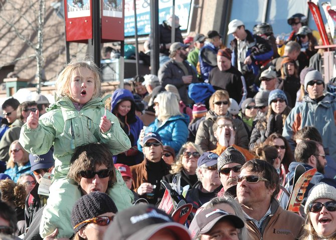 Olivia Rossi enjoys the music of the Sam Bush Band on Friday from the shoulders of her father, Phillip, during a Bud Light Rocks the Boat free concert at the base of Steamboat Ski Area.
