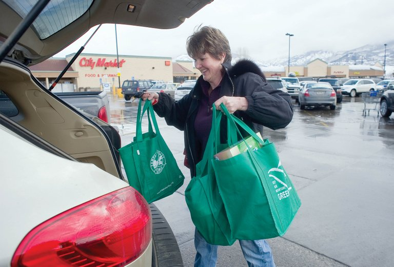 Kathy Vaynkof carries reusable grocery bags while shopping Thursday at City Market in Steamboat Springs. A growing group of residents is hoping to assess fees on or ban disposable, plastic bags at Steamboat stores. Telluride's plastic-bag ban started March 1.