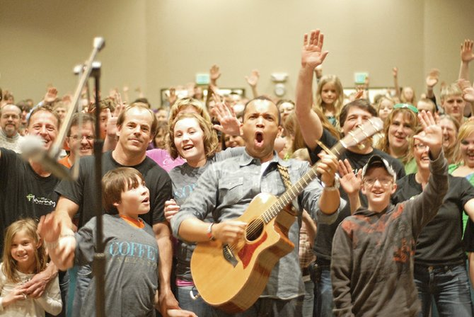 Musician Coffey Anderson stands among his audience Sunday evening at The Journey at First Baptist in Craig. Anderson encouraged audience participation, which, at one point, involved a Daily Press photographer. The concert raised $4,500 for Celebrate Recovery.