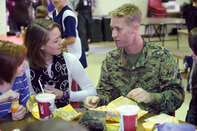 Lance Cpl. Nathan Greenwall stopped by Steamboat Springs Middle School on Monday to have lunch with his sister, Savanah Maxwell, center. Greenwall will be leaving for Afghanistan later this week.